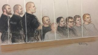 Court artist drawing of six alleged members of National Action