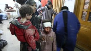 Wounded Syrians seek treatment at a makeshift hospital in Kafr Batna, in the besieged rebel-held Eastern Ghouta, following reported Syrian government air strikes (21 February 2018)