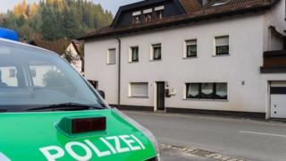 A police car sits on 13 November 2015 in front of a house in Wallenfels, southern Germany, where the bodies of infants were discovered the day before