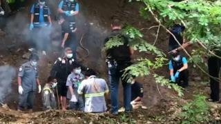 Forensic experts and police excavate the bodies of Alan Hogg and his Thai wife in Phrae, northern Thailand