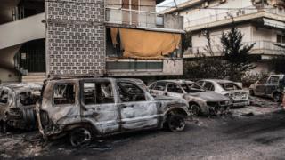 Damaged vehicles in Rafina, Greece