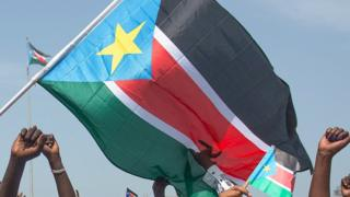 People waving the South Sudanese flag - 2015