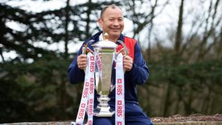 England rugby union coach Eddie Jones poses with the Six Nations trophy