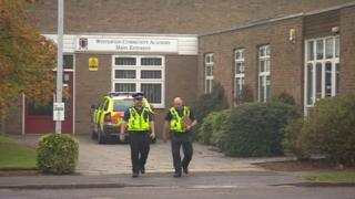 Police officers walking away from Winterton Community Academy