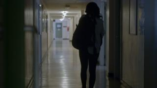 Girl walking in school corridor