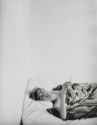 Stephen Linard lies in bed, c.1982–83