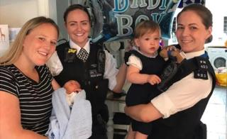 Rebecca Fox holding baby Bobby, PC Holly Foran and PC Nicola Devlin with Bobby's sister Marnie