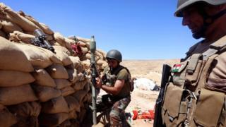 Iraqi Kurdish forces battle Islamic State near Mosul