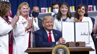 Trump US President Donald Trump shows one of the four executive orders he signed to lower prescription drug prices in the US. Photo: 24 July 2020