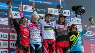 Rachel Atherton, middle, celebrating her win