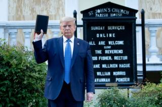 Trump holds Bible outside church