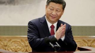 China's President Xi Jinping claps