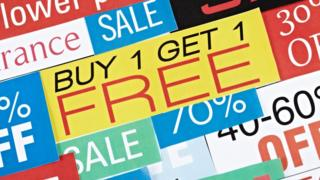 Signs for buy-one-get-one-free and other deals