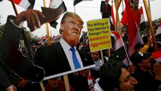 Donald Trump Supporters of Iraqi Shia cleric Moqtada al-Sadr carry placards depicting Donald Trump