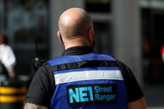 A street ranger patrols Northumberland Street amid the spread of the coronavirus disease in Newcastle
