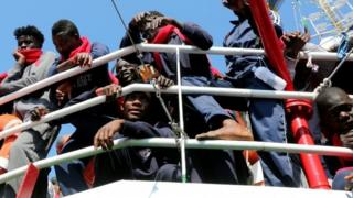 Migrants wait to disembark as they arrive at the Crotone harbour, Italy. Photo: 21 June 2017