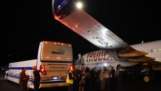 A bus ferrying journalists collided with the wing of Liberal leader Justin Trudeau's chartered Boeing on the first night of the election campaign.