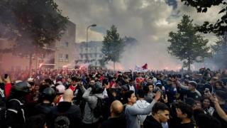 Ajax fans gather outside of the family home of Dutch midfielder Abdelhak Nouri on July 14, 2017 in Amsterdam