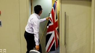Brussels official carrying UK flag, 20 Jul 17