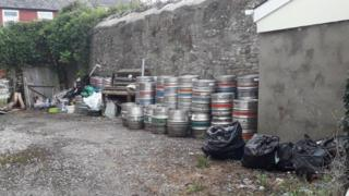 Waste dumped by the pub
