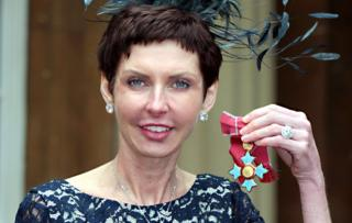Denise Coates collecting CBE in 2012