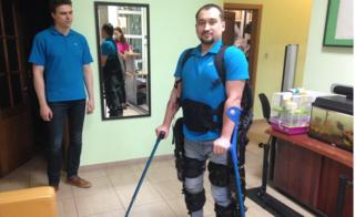 A paralysed man wearing an ExoAtlet exoskeleton