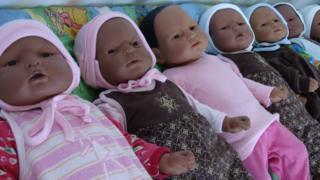 Realistic looking baby dolls.