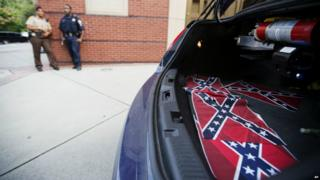Confederate flags sit in the back of a police car outside Ebenezer Baptist Church in Atlanta - 30 July 2015