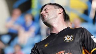 Padraig Amond of Newport County rues a missed chance
