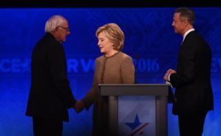 "US Democratic presidential hopefuls (L-R) Bernie Sanders, Hillary Clinton and Martin O""Malley greet each other"