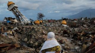 A woman who lost her nephew in last week's earthquake stands in the Balaroa neighbourhood in Palu, Sulawesi Island, Indonesia October 7, 2018.