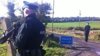 Police guarding the outer cordon of the security operation in County Fermanagh in October 2014