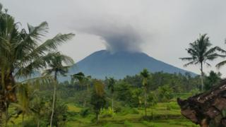 Towering clouds of smoke on the summit of Mount Agung in the holiday island of Bali.