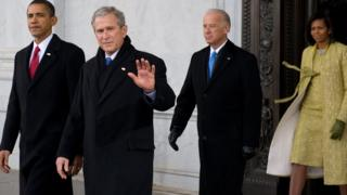 George Bush waves before leaving the White House