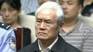 Zhou Yongkang attends his sentence hearing in a court in Tianji in China on 11 June 2015.