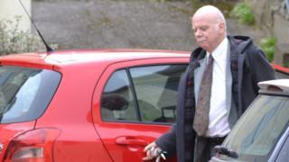 Dr Rory Lyons outside the Eagle Medical Practice in Alderney