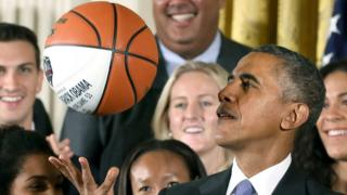 President Obama, shown with a basketball in 2015