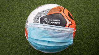 An image of a football and a face mask