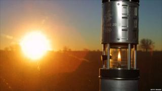 The Olympic flame is transported in the Olympic lantern at sunrise during the 2002 Salt Lake Olympic torch relay in Wichita, Kansas