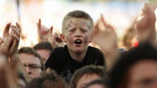 Boy in crowd at Glastonbury