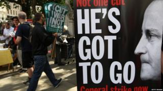 "Placard with David Cameron's face and the slogan ""He's got to Go"""