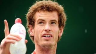 Andy Murray looks at the rain