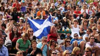 Murray fans hold up a Scottish flag on Murray Mount