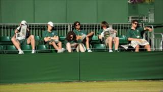 Ground staff relax in the sun