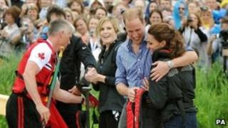 Prince William hugs his wife