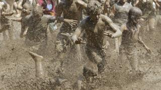 Thousands of people attend annual Mud Festival in America