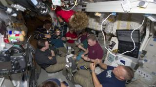 Crew having a last supper on the ISS