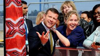 Dermot O'Leary poses with fans on the red carpet at the launch of the new series of The X Factor.