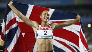 Jessica Ennis holding a union jack flag after winning a silver medal at the 2011 Athletics World Championships in Daegu