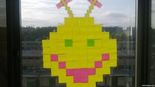 Smiley face made from sticky notes
